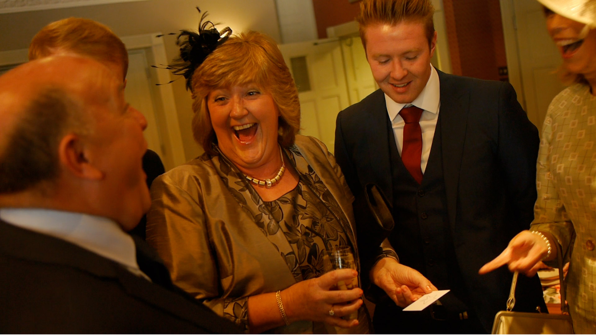 A crowd reacts to Wedding Magician Aaron Calvert