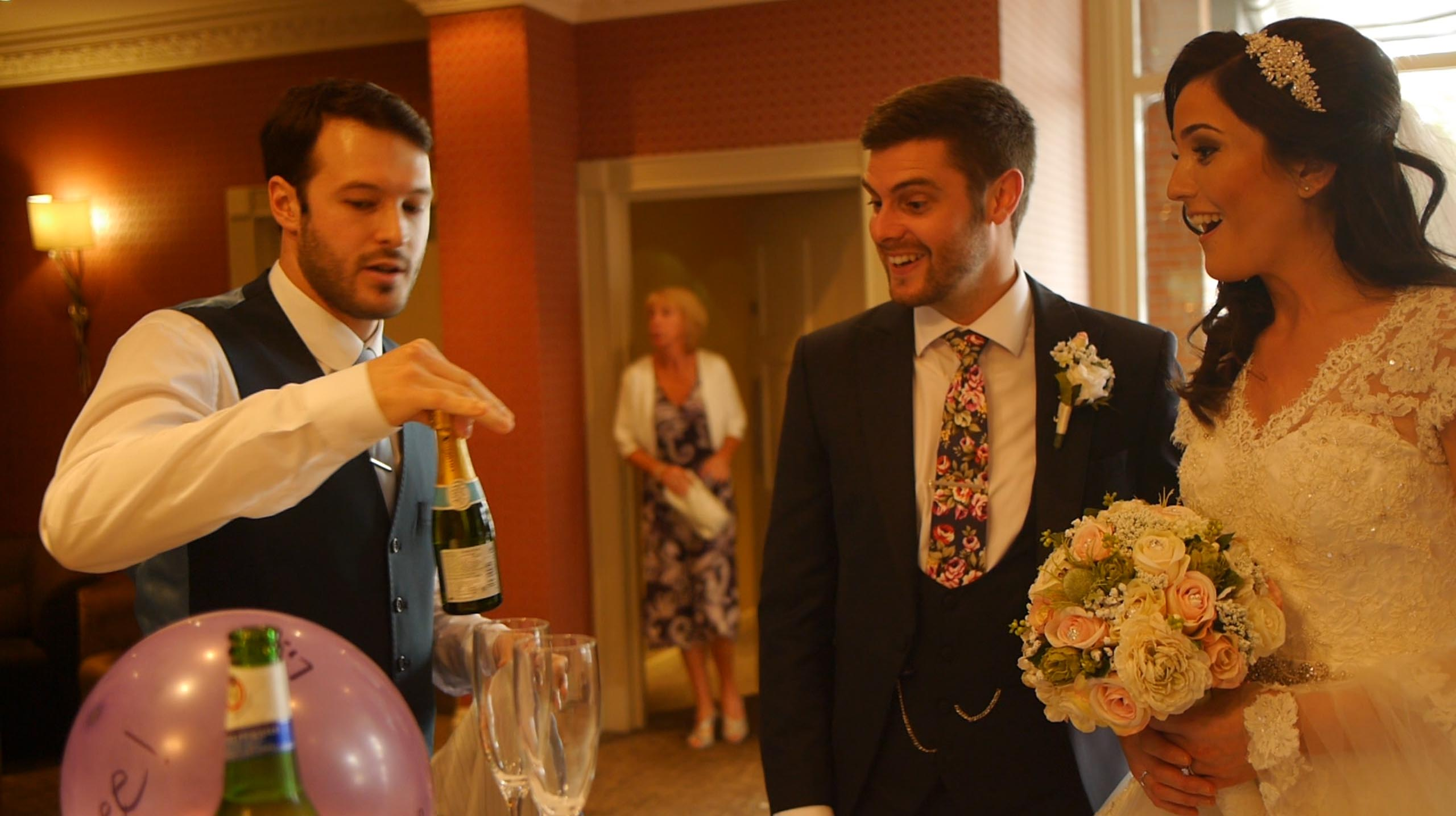 close up wedding magician shocks bride and groom