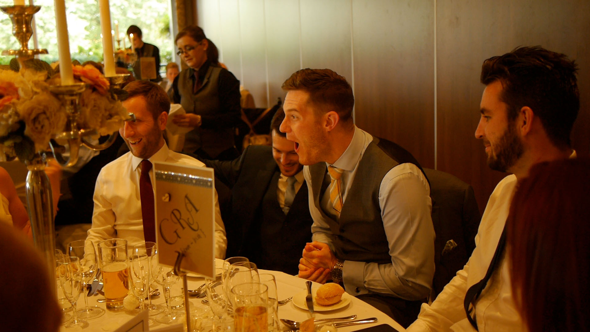 Manchester corporate close up magician wows table audience