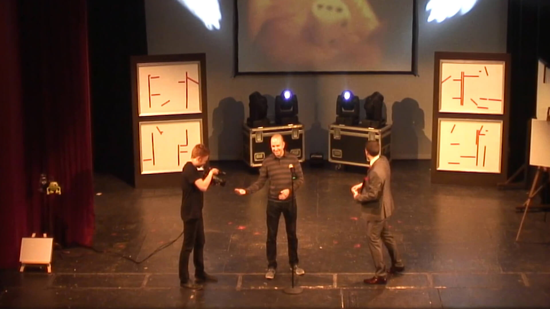 Aaron in a theatre performing stage entertainment