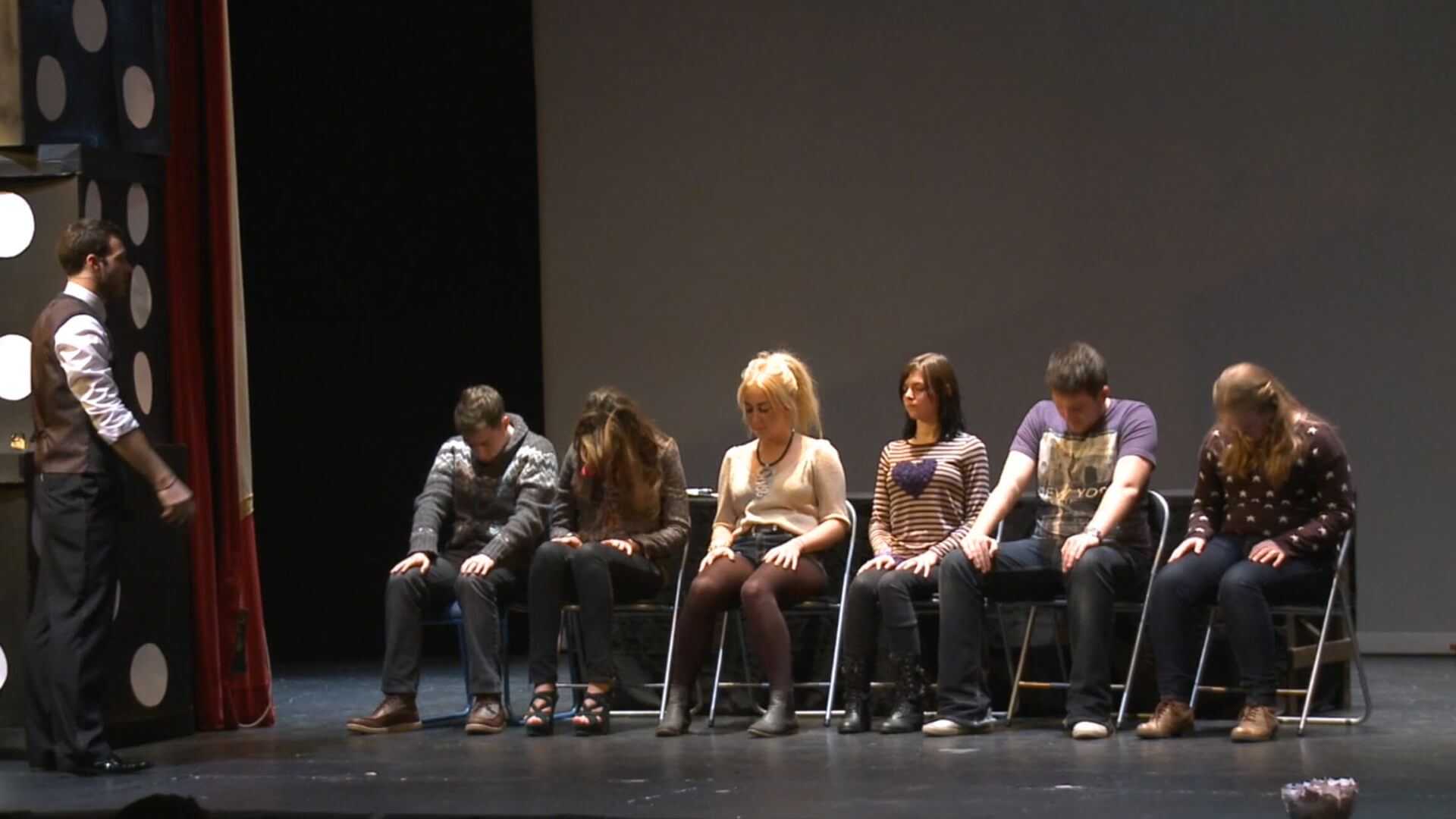 Aaron performing hypnosis on stage entertainment